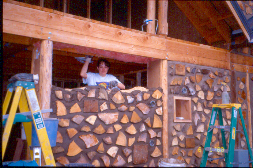 Linda building the cordwood wall