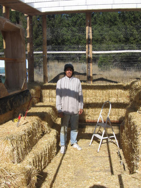 Chris with local straw bales.